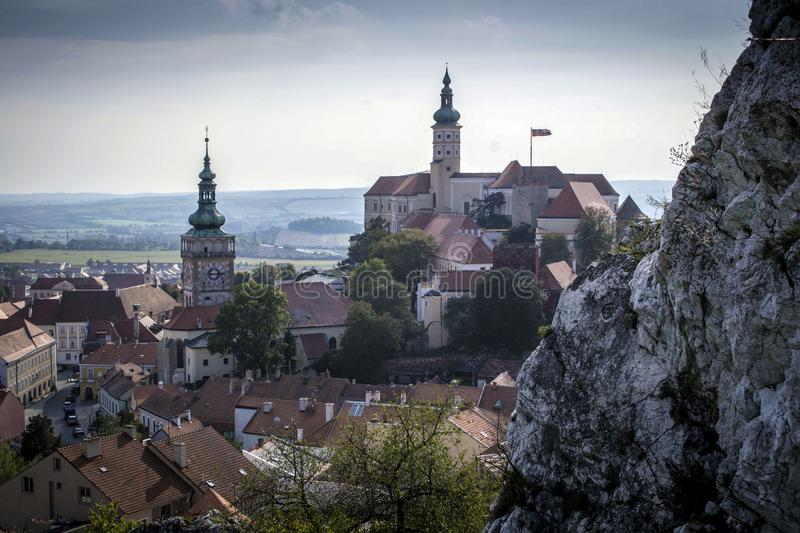 High rock and the castle tower in the South Moravian royalty free stock photo