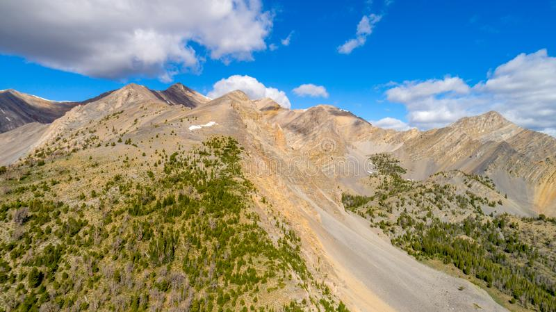 High Rocky Mountains in central Idaho with white puffy clouds royalty free stock image