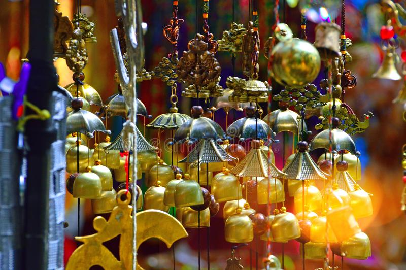 Colored glass, and copper wind chime. High ropes in an adult adventure park where people play sports and relax royalty free stock photo