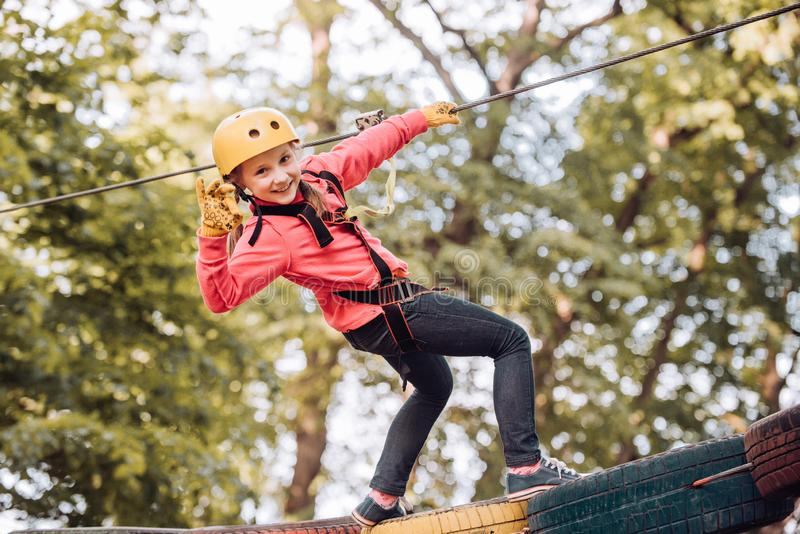 High ropes walk. Active children. Playground. Eco Resort Activities. Happy child boy calling while climbing high tree stock images