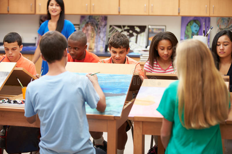 High School Art Class With Teacher. In Classroom royalty free stock photo