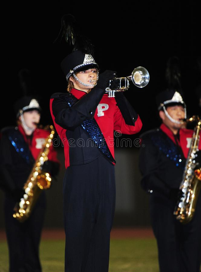 High School Band. Preforming during at half time during a High School football game. A school band is a group of student musicians who rehearse and perform stock photo