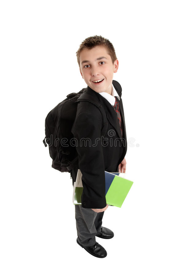 High School boy carrying bag and books stock images