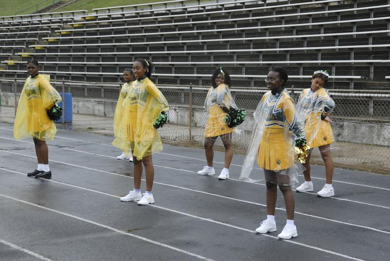 High school cheerleaders in the rain cheering their team in Lahnam, Maryland stock photography