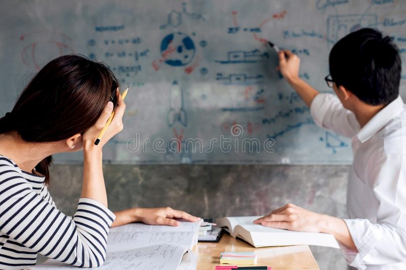 High school or college student group catching up workbook and le stock photo