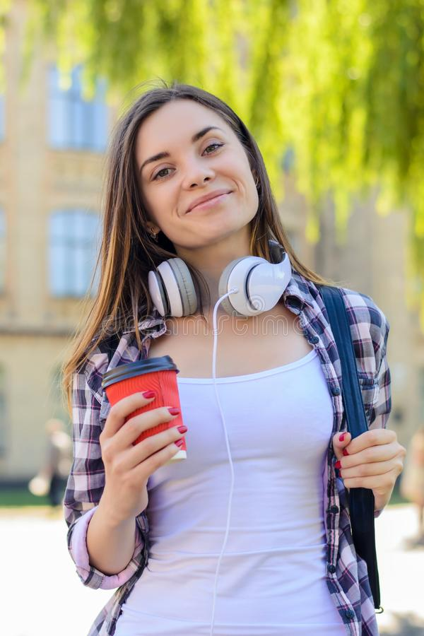 High school education student college break rest relax recreation concept. Happy cheerful smiling young student listening to music royalty free stock images