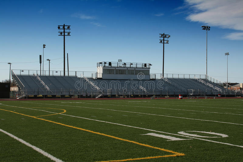 High School Football Field. Small town High School football field with announcers box. 10 yard line in view stock image