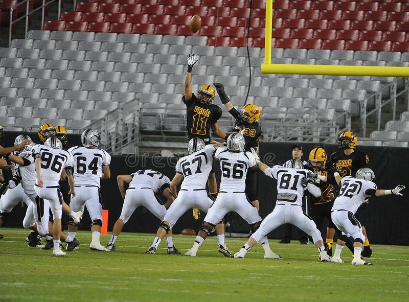 High School Football Game. High School Football game action. This game was in Phoenix in the state of Arizona stock image