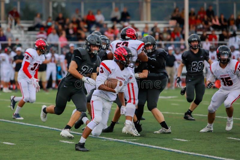 High school football game action royalty free stock photos