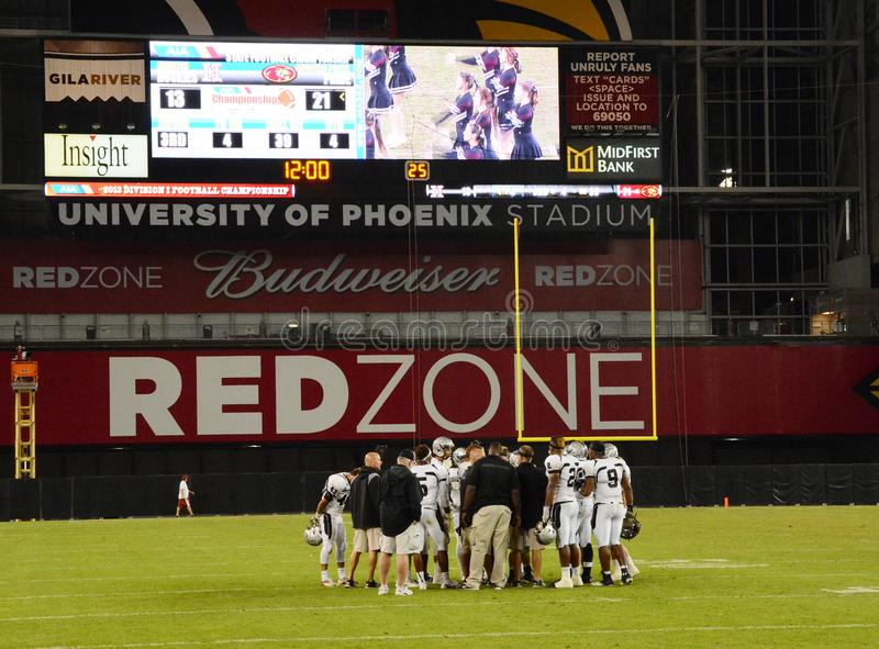 High School Football Game. High School Football game action. This game was in Phoenix in the state of Arizona royalty free stock image