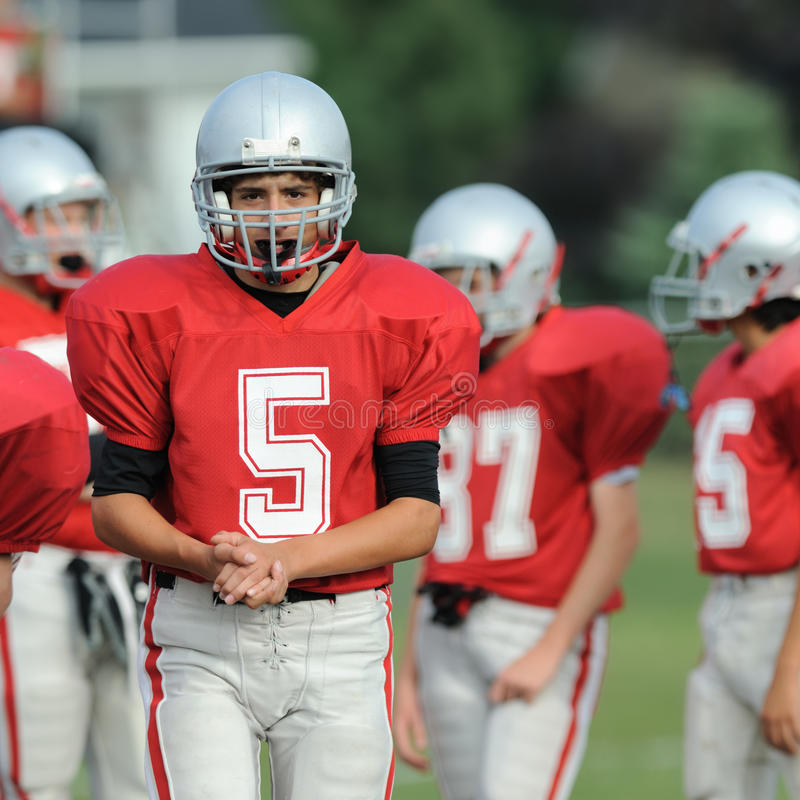 High school football player. Walks away from huddle stock image
