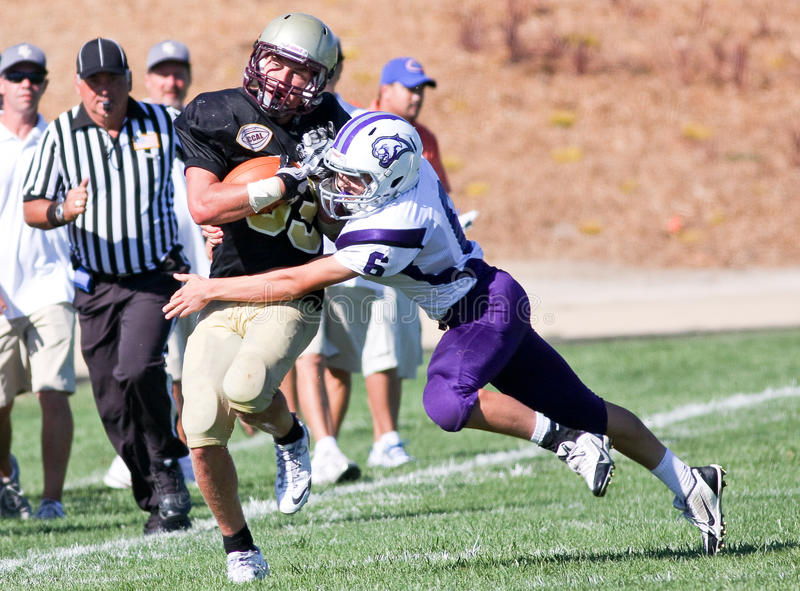 High School Football Player Being Tackled During a Game. A football player from Scotts Valley High School in California, about to be tackled during a game stock images