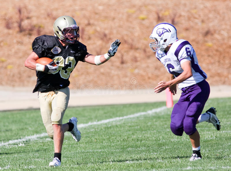 High School Football Player Running with the Ball During a Game. A football player from Scotts Valley High School in California, being chased during a game stock photo