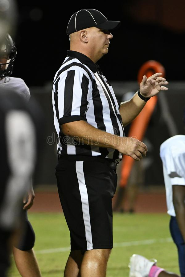 High School Football Referees. High School Referees team working in Chandler Arizona during a game stock photography