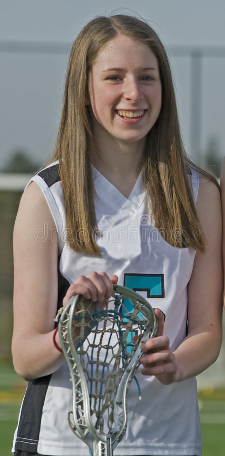 High School Girls Lacrosse player. High School Girls Varsity lacrosse player with stick ready for the game to start royalty free stock photo