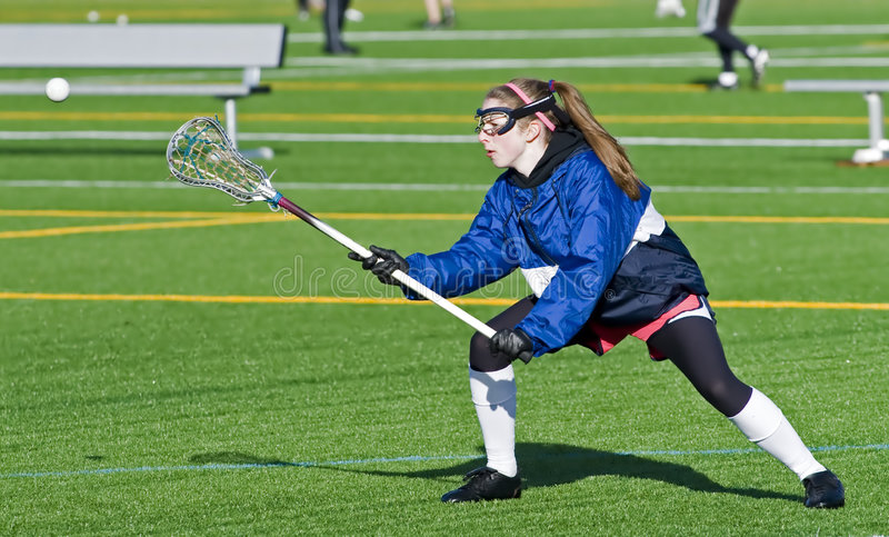 High School Girls Lacrosse practice. 17 yo High School Girls lacrosse player reaching for the ball durring practice stock photos