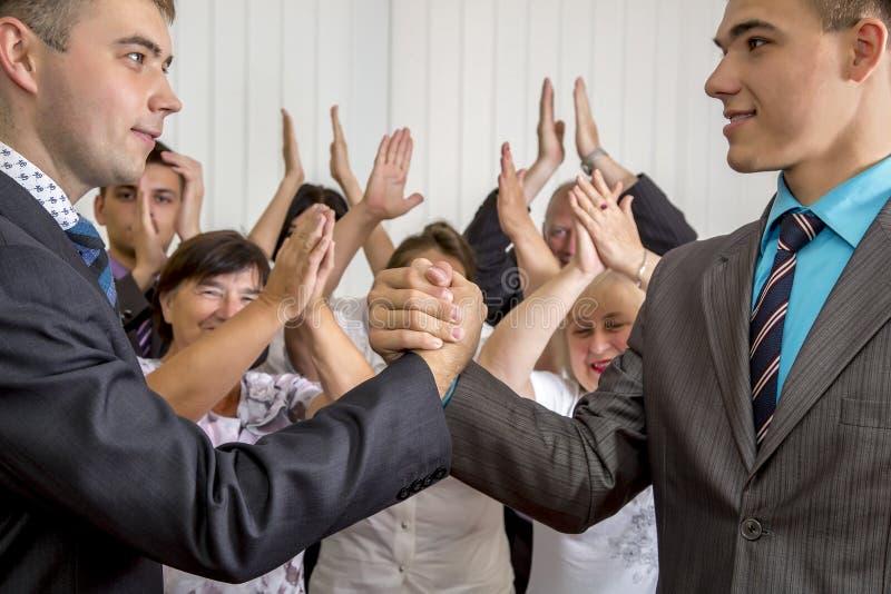 High school graduates shaking hands royalty free stock photo