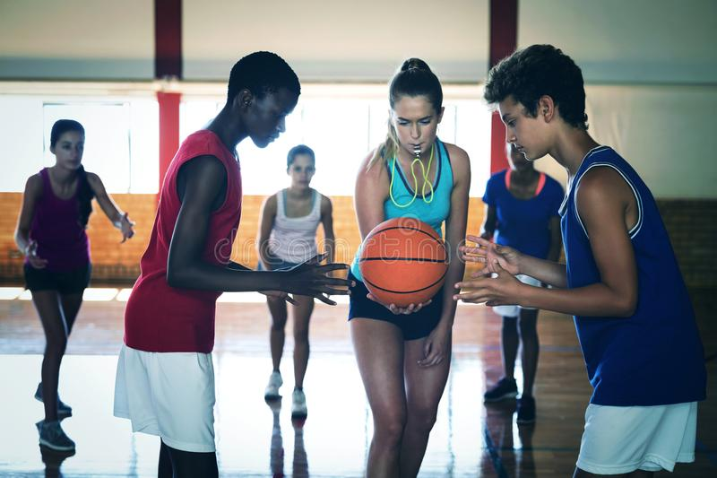 High school kids about to start playing basketball royalty free stock image