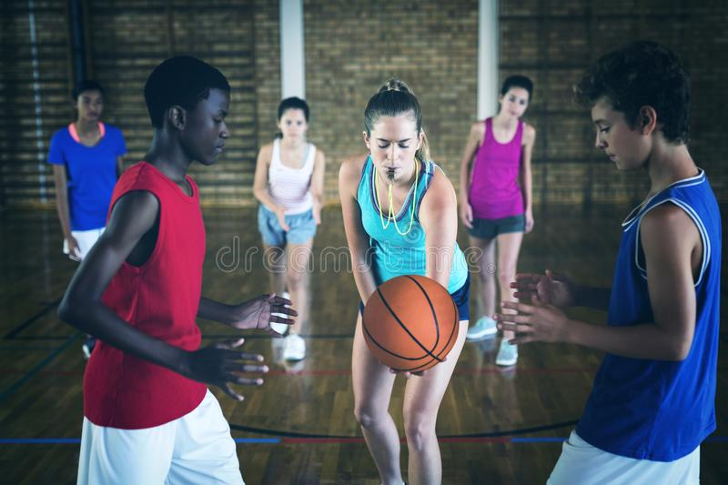High school kids about to start playing basketball stock photo
