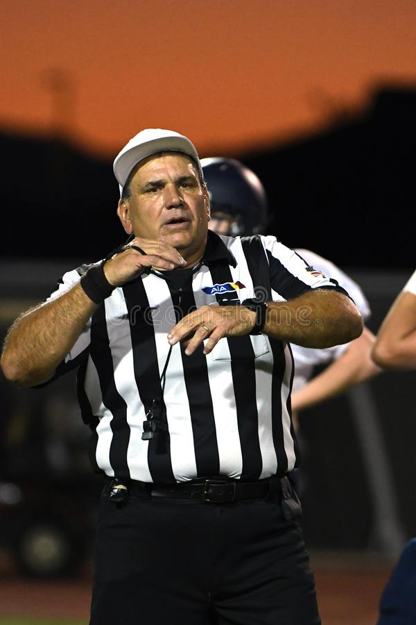 High School Football Referees. High School Referees team working in Chandler Arizona during a game stock photos