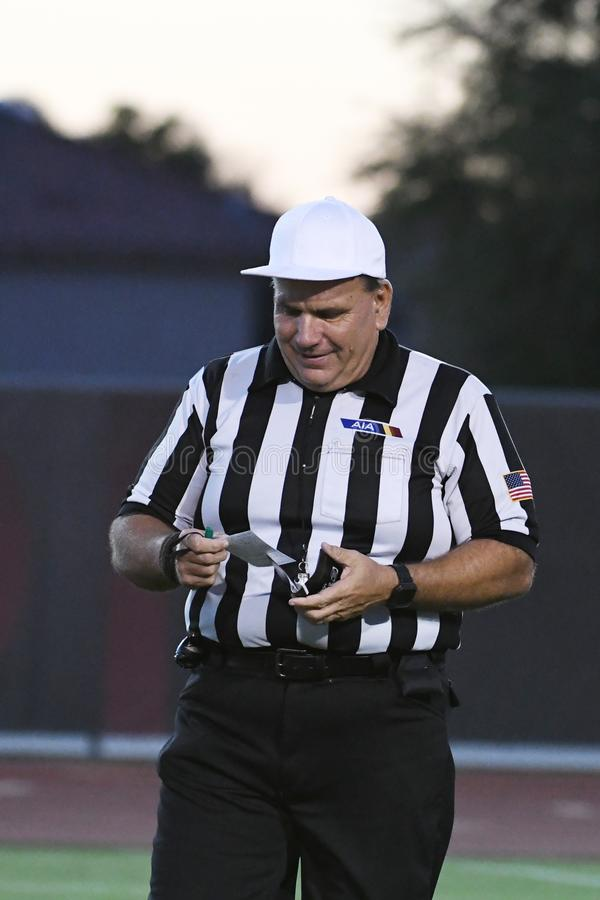 High School Football Referees. High School Referees team working in Chandler Arizona during a game royalty free stock image