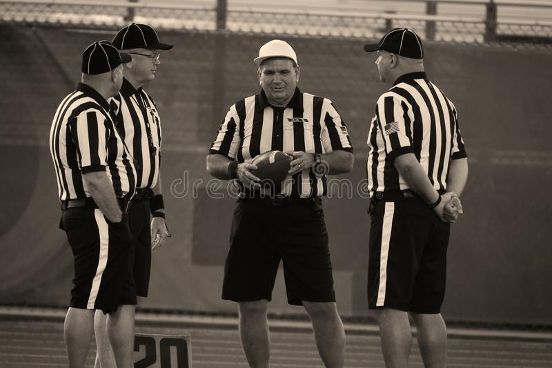 High School Football Referees. High School Referees team working in Chandler Arizona during a game stock image