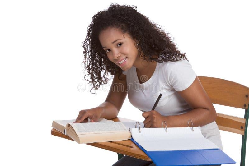 High school schoolgirl student by desk studying