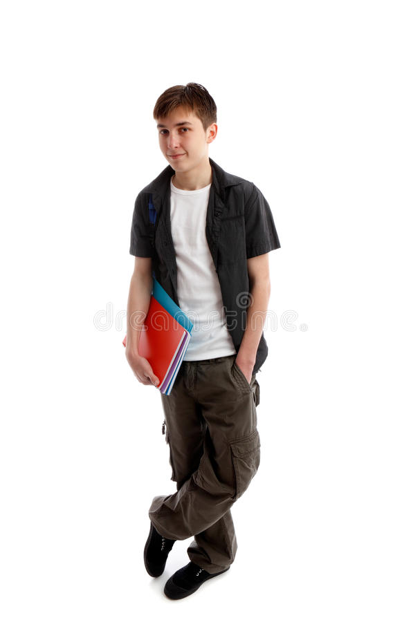 High School student. A high school or college student stands in casual clothes and carrying some books under one arn. White background stock photography