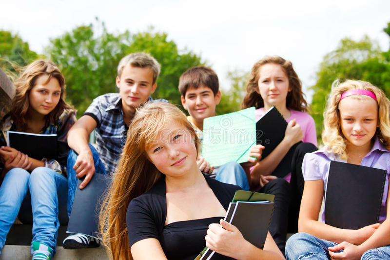 High school students. Group of high school students with books in hands