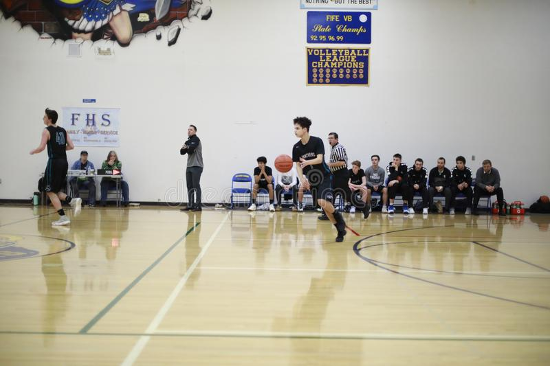 High School Indoor Basketball Game. High school students play an indoor basketball game stock images