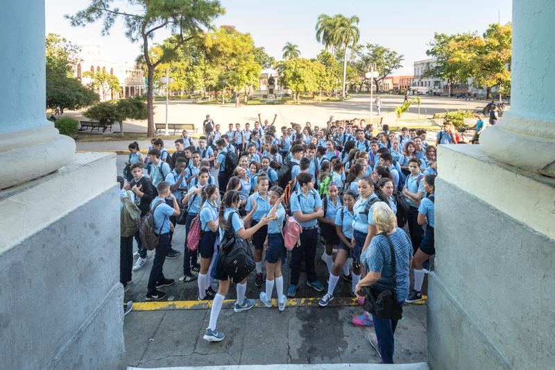 High school students, Santa Clara, Cuba. High school students in the Osvaldo Herrera building. After the morning meeting the start entering the education center stock photo