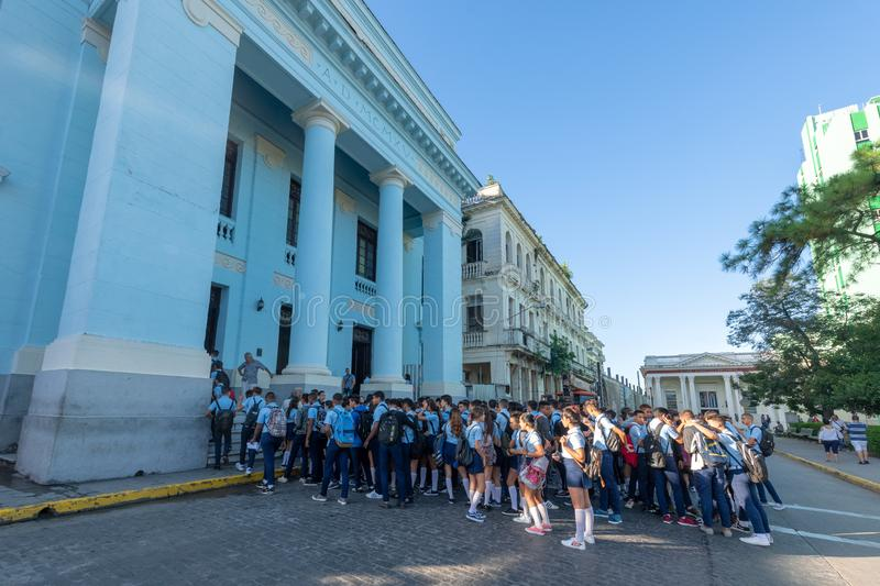 High school students, Santa Clara, Cuba. High school students in the Osvaldo Herrera building. After the morning meeting the start entering the education center stock images