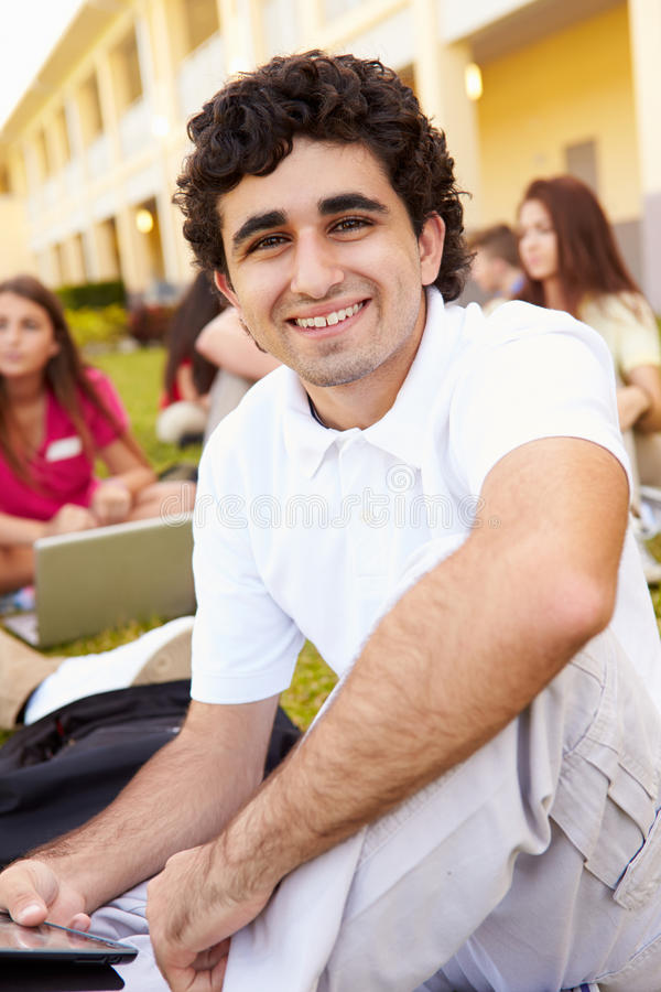 High School Students Studying Outdoors On Campus. Close Up Of High School Students Studying Outdoors On Campus Using Laptops stock photo