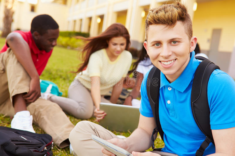 High School Students Studying Outdoors On Campus. Using Laptops And Digital Tablets royalty free stock photography