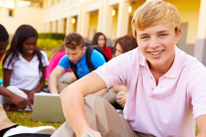 High School Students Studying Outdoors On Campus. Using Laptops WorkingTogether royalty free stock photo