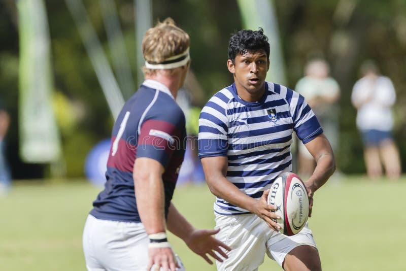 High Schools das ?as equipes da ação do rugby fotografia de stock
