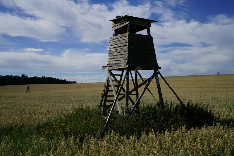 High seat in a large field royalty free stock photo
