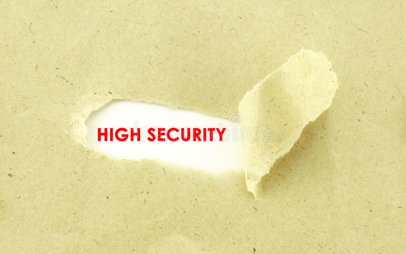 HIGH SECURITY. Text HIGH SECURITY appearing behind torn light brown envelope stock photos