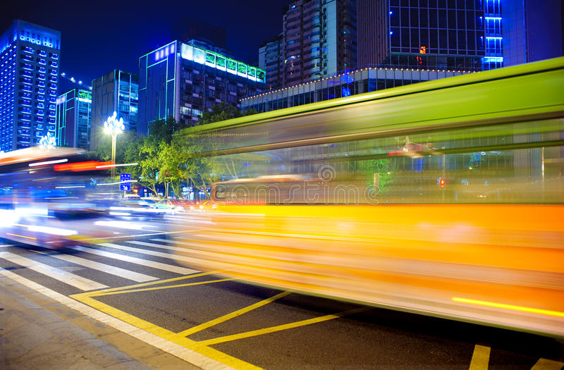 High speed and blurred bus light trails. In downtown night scenes royalty free stock photography