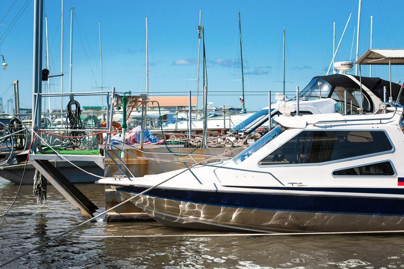 High-speed boat on the pier in sunny day. stock photography