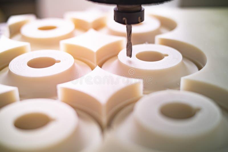 High speed cnc machine mills in plastic parts. Cnc machine mills in plastic part with a finishing cutter stock photo