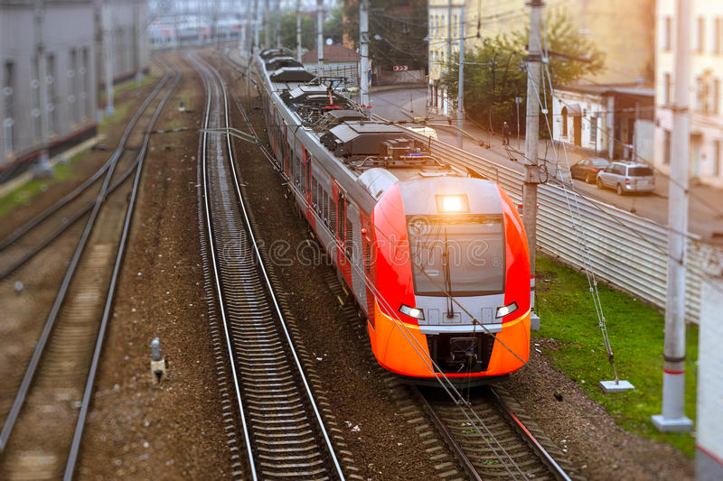 High-speed electric train, railway. Modern electric locomotive pulling a high-speed train on rails. Technical railway depot on autumn morning in fog. Transport stock photos