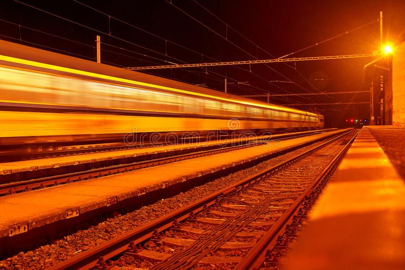 High speed passenger train on tracks with motion blur effect at night. Railway station in the Czech Republic stock photos