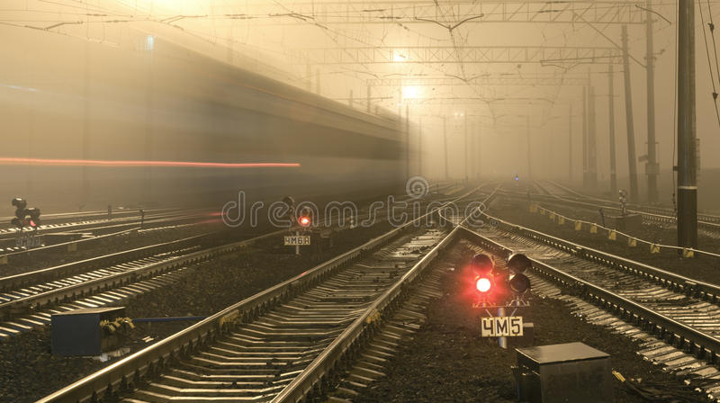 High speed passenger train on tracks with motion blur effect royalty free stock image