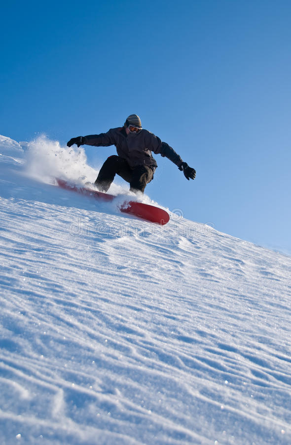 High Speed Snowboarder, Snow Flying stock photo