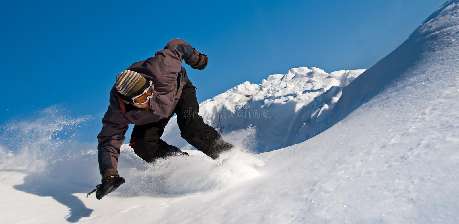 High Speed Snowboarder, Snow Flying royalty free stock photography