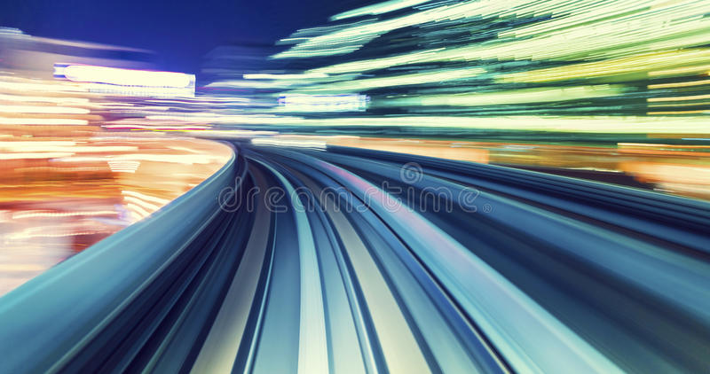 High speed technology concept via a Tokyo monorail. Abstract high speed technology POV motion blurred concept image from the Yuikamome monorail in Tokyo Japan