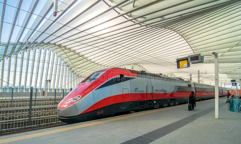 High Speed Train and Station in Reggio Emilia, Italy. REGGIO EMILIA, ITALY - MARCH 12, 2015: train and passengers in High Speed Train Station in Reggio Emilia royalty free stock photography