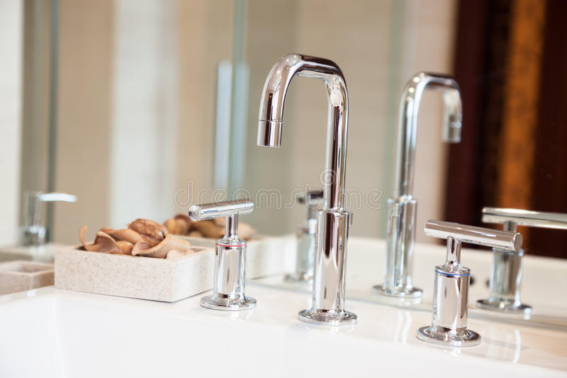 Download High Spout Faucet And Bowl  In Front Of A Mirror Stock Image - Image: 26535745