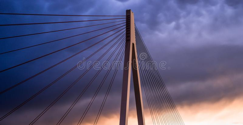 High suspended road bridge in Germany against a dark stormy sky at sunset. royalty free stock images